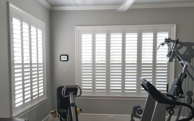 Cincinnati fitness room with shuttered windows.